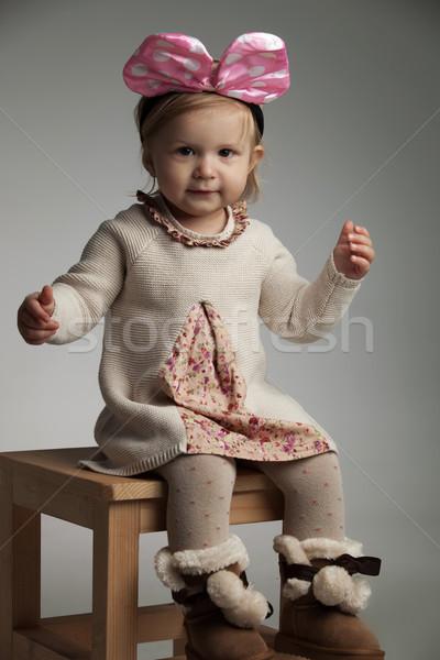 seated little beautiful girl wearing a pink bow headband  Stock photo © feedough