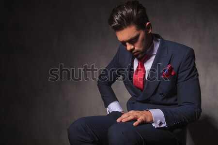 pensive businessman smiling while looking to side Stock photo © feedough