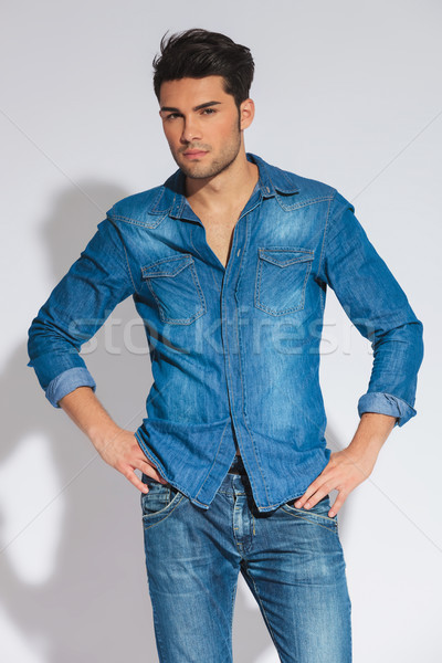 confident casual man standing with hands on hips Stock photo © feedough