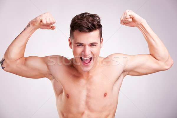 Well-built muscularyoung man screams Stock photo © feedough