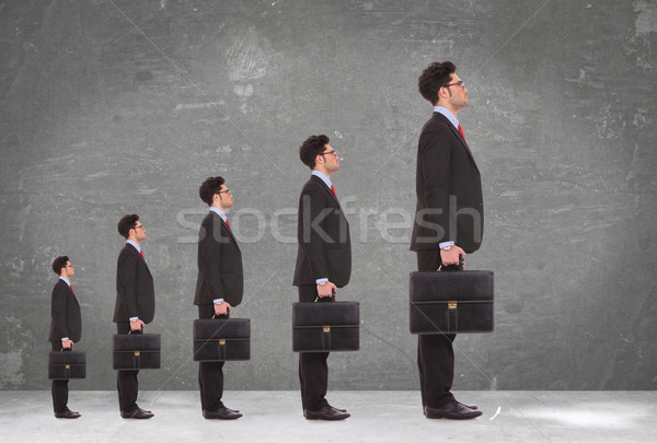 5 business men holding briefcases standing in a row Stock photo © feedough