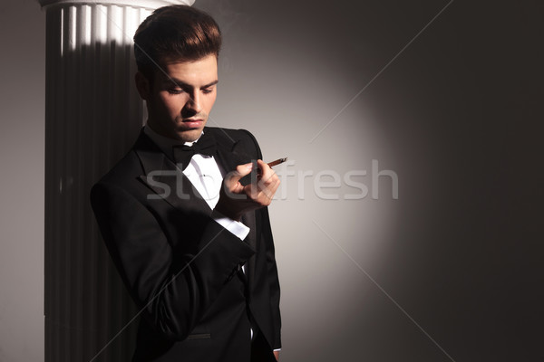 business man leaning on a white column  Stock photo © feedough