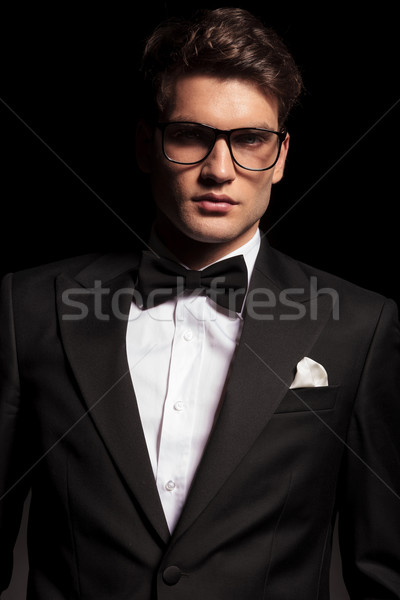 elegant young man wearing a tuxedo and glasses. Stock photo © feedough