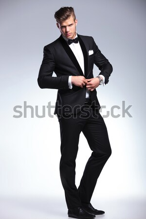 confident elegant man resting his foot on a wooden box Stock photo © feedough