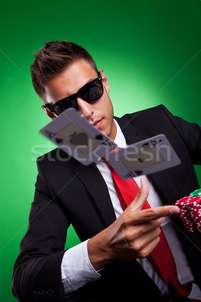 Young business man throwing a pair of aces Stock photo © feedough