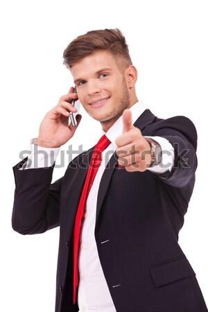 ストックフォト: ビジネスマン · 電話 · 親指 · アップ · 小さな