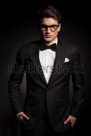 side view of a fashion man in tuxedo looking away Stock photo © feedough