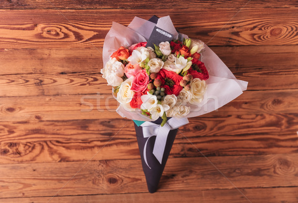 colorfull flowers bouquet in a cone with card and bow  Stock photo © feedough