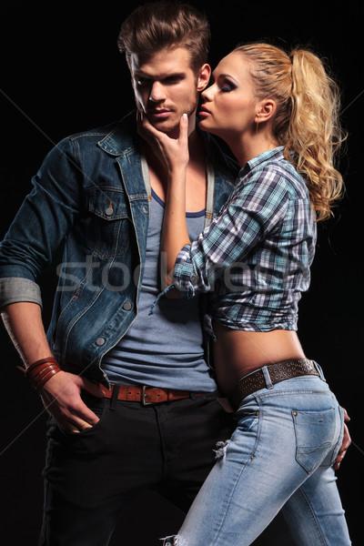 Mulher loira beijo namorado bochecha quente homem Foto stock © feedough