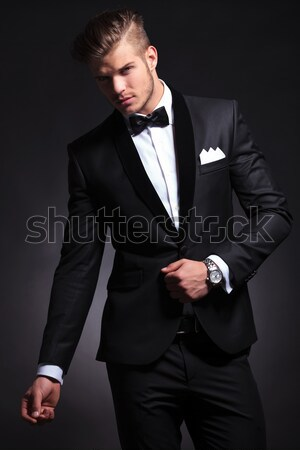portrait of confident young businessman sitting on wooden chair Stock photo © feedough