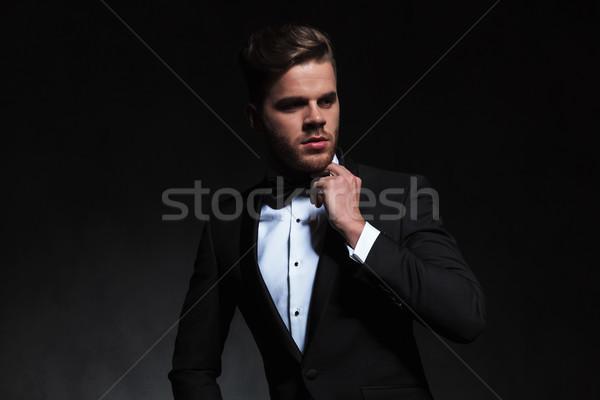 portrait of pensive elegant man in tuxedo looking to side Stock photo © feedough