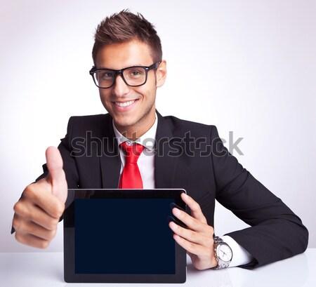 Foto stock: Homem · de · negócios · trabalhando · laptop · assinar