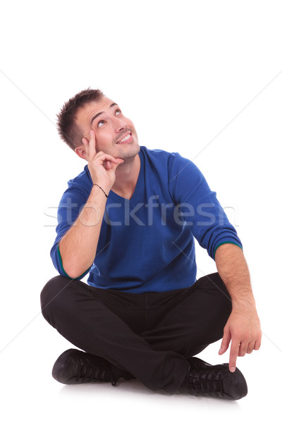 Happy smiling man looking up Stock photo © feedough