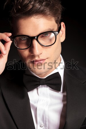 handsome business man putting on his glasses Stock photo © feedough