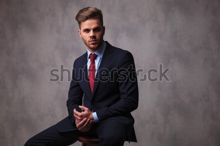 Young business man fixing his collar  Stock photo © feedough