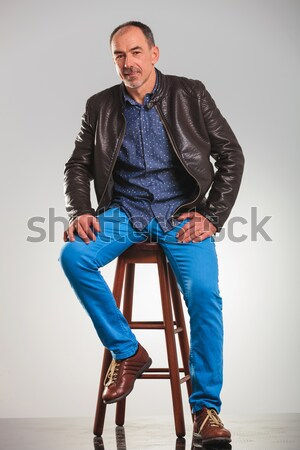 Smart casual blond man sitting on a chair Stock photo © feedough