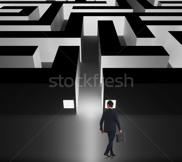 Stock photo: walking businessman deciding whether to enter the business maze