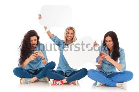 three young women making the no evil poses sitting Stock photo © feedough