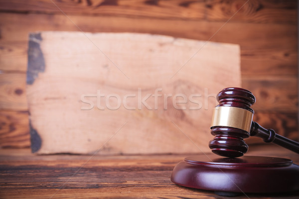 judge's gavel in front of a bog oak board  Stock photo © feedough