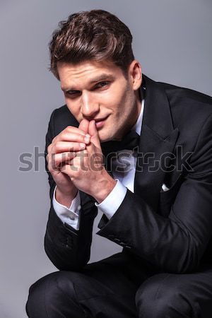 seated man in tuxedo is sitting and praying Stock photo © feedough