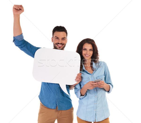 woman texting while man holds speech bubble and celebrate succes Stock photo © feedough