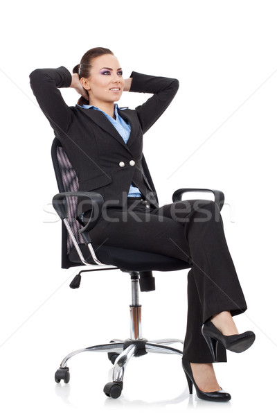 woman leaning  in a black chair Stock photo © feedough