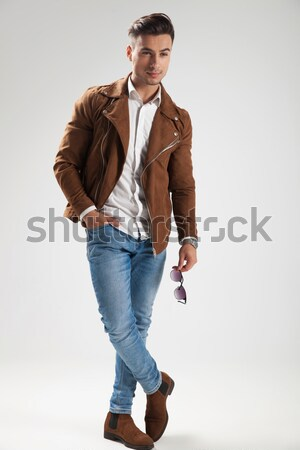 smart casual young man standing on studio background Stock photo © feedough