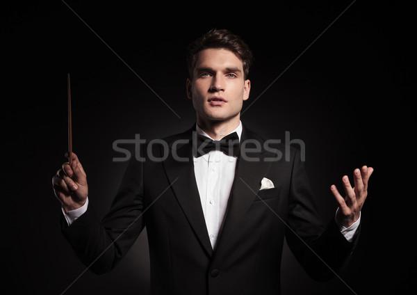 Bel homme orchestre jeunes affaires musique heureux Photo stock © feedough