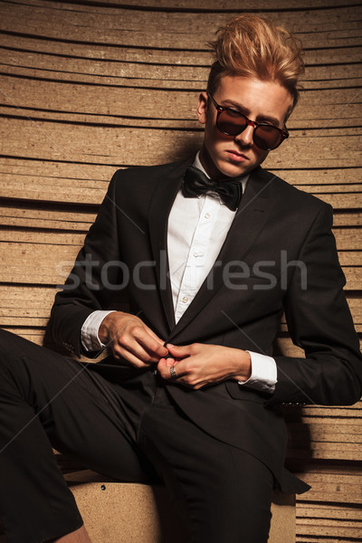 Blond young business man closing his jacket  Stock photo © feedough