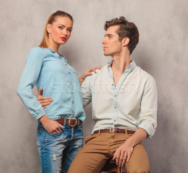 man embracing his girlfriend while she rests one hand on his sho Stock photo © feedough