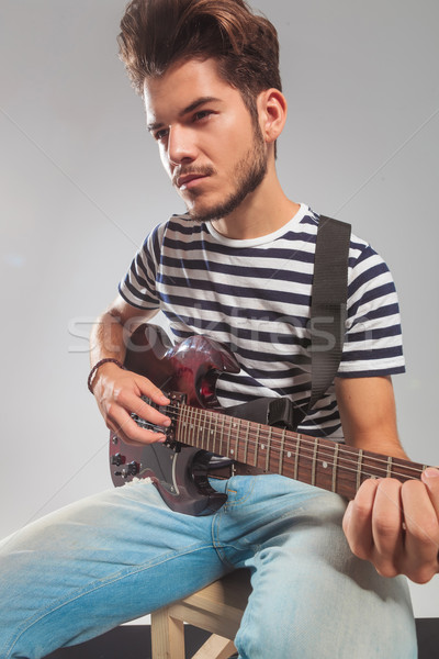 guitarist in studio playing his instrument looking away Stock photo © feedough