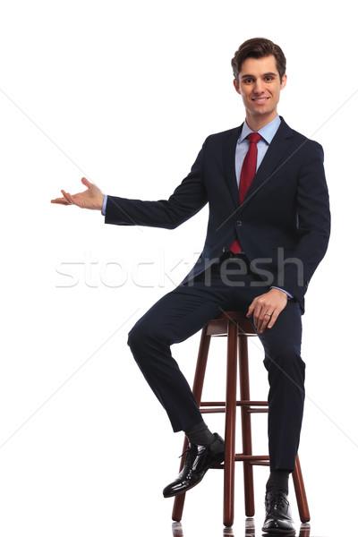 улыбаясь сидящий бизнесмен что-то белый Сток-фото © feedough