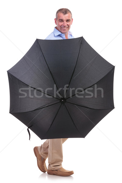 casual middle aged man behind an umbrella Stock photo © feedough
