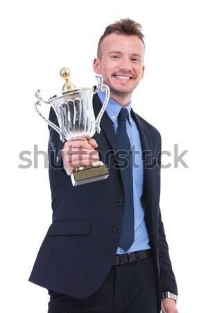 Człowiek biznesu uśmiecha trofeum ręce uśmiechnięty Zdjęcia stock © feedough