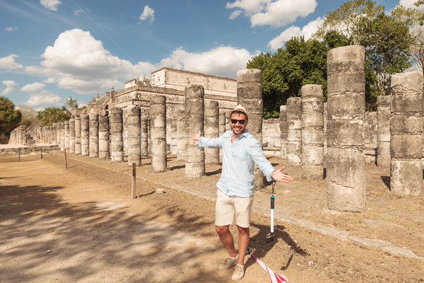 Happy man inviting you to visit the ruins Stock photo © feedough