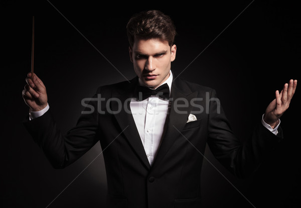 Young orchestra conductor holding a stick  Stock photo © feedough