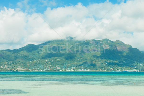 tropical clear water with mountains and blue sky Stock photo © feedough