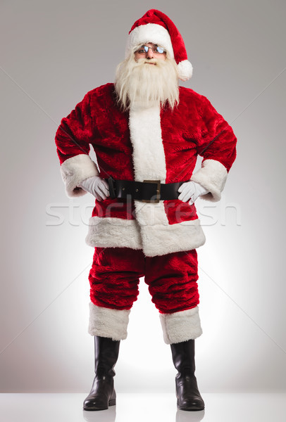 santa claus standing with hands on waist  Stock photo © feedough