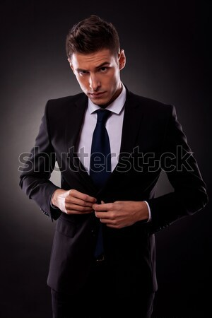 businessman buttoning jacket, getting dressed Stock photo © feedough