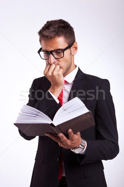 business man reading the thriller book Stock photo © feedough