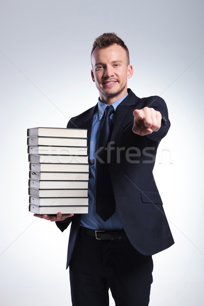 Stock photo: man with many books points at you