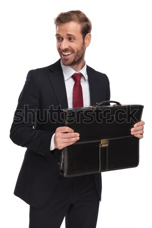 smiling young business man touching the screen of his tablet Stock photo © feedough