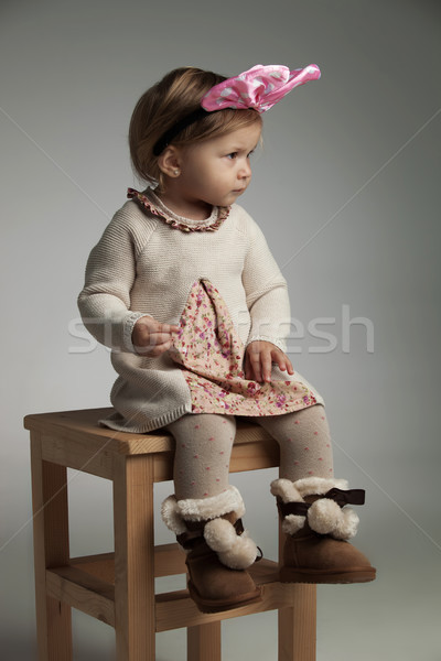 side view of a cool little girl wearing pink bow headband Stock photo © feedough