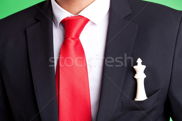 Business man holding a white chess king in his pocket Stock photo © feedough