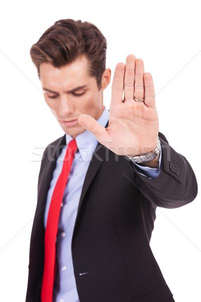 Sério homem de negócios pare gesto branco Foto stock © feedough
