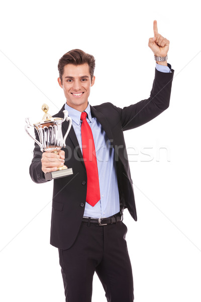 Happy business man holding a trophy Stock photo © feedough
