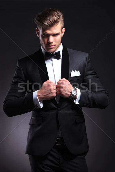 business man with both hands on collar Stock photo © feedough