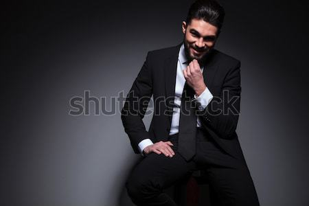Handsome young elegant business man sitting on a stool Stock photo © feedough