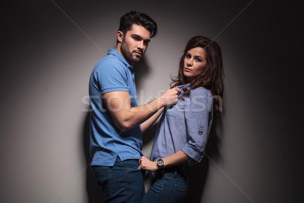 fashion man pulling his girlfriend towards him  Stock photo © feedough