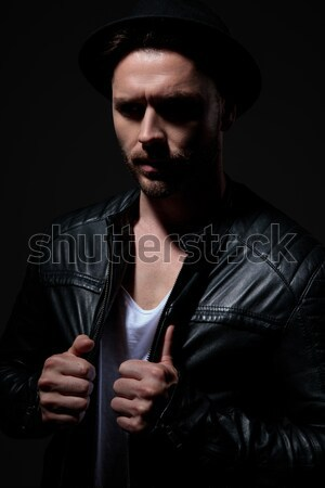 side view portrait of a dramatic man in leather jacket Stock photo © feedough